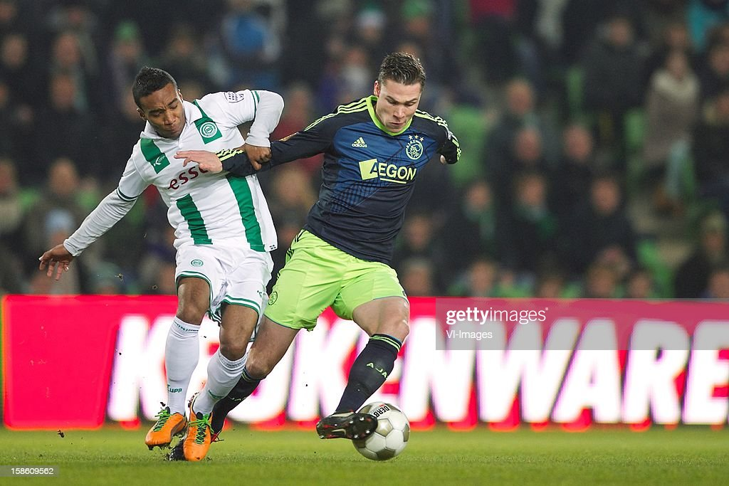 Lorenzo Burnet of FC Groningen, Derk Boerrigter of Ajax during the Dutch Cup match between FC Groningen and Ajax Amsterdam at the Euroborg on December 20, 2012 in Groningen, The Netherlands.