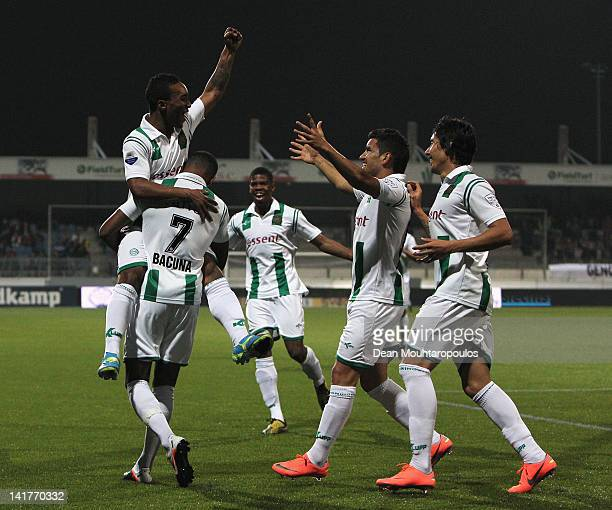 Lorenzo Burnet of Groningen is congratulated by team mates after he scores the first goal of the game during the Eredivisie match between SC...