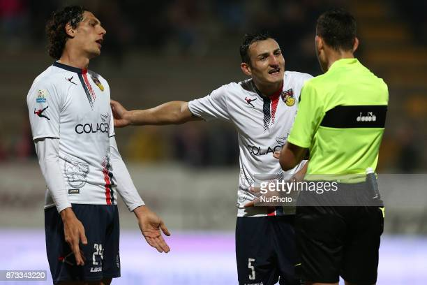 Lorenzo Burzigotti of AS Gubbio 1910 and Emilio Dierna of AS Gubbio 1910 protests to referee after the penalty grant fo Teramo Calcio 1913 during the...
