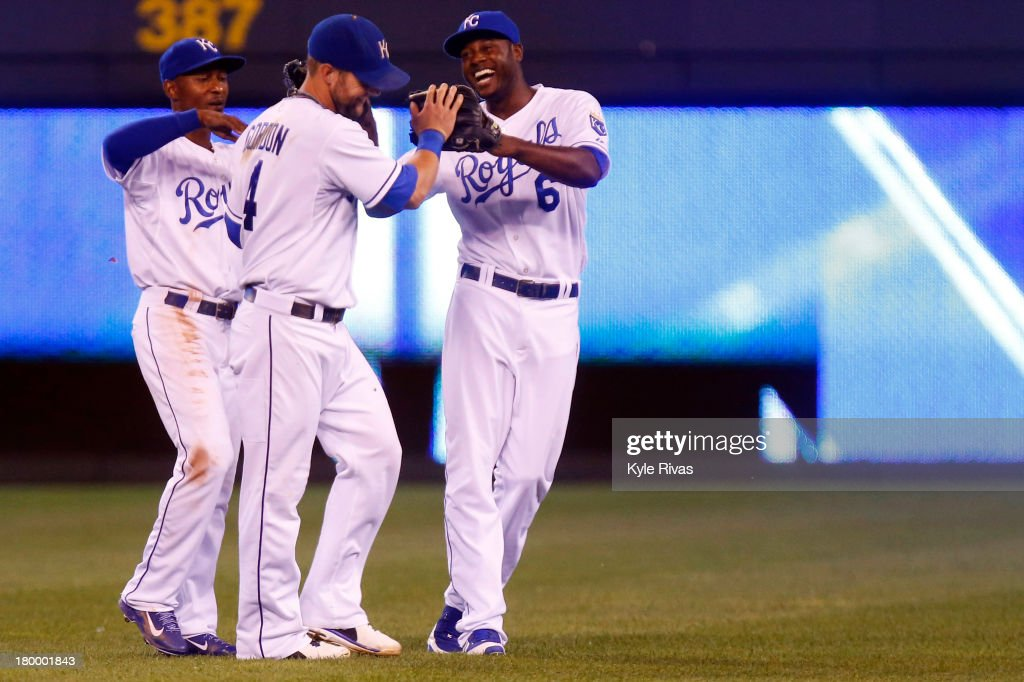 <a gi-track='captionPersonalityLinkClicked' href=/galleries/search?phrase=Lorenzo+Cain&family=editorial&specificpeople=5746615 ng-click='$event.stopPropagation()'>Lorenzo Cain</a> #6, <a gi-track='captionPersonalityLinkClicked' href=/galleries/search?phrase=Alex+Gordon+-+Baseball+Player&family=editorial&specificpeople=4494252 ng-click='$event.stopPropagation()'>Alex Gordon</a> #4, and Jarrod Dyson #1 of the Kansas City Royals celebrate the 4 to 3 victory over the Detroit Tigers on September 7, 2013 at Kauffman Stadium in Kansas City, Missouri.