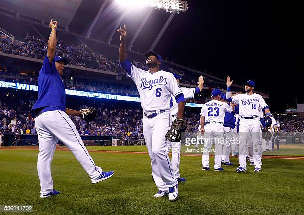 Lorenzo Cain and Salvador Perez of the Kansas City Royals celebrate after the Royals defeated the Tampa Bay Rays 105 to win the game at Kauffman...