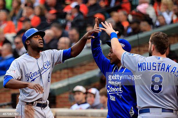 Lorenzo Cain celebrates after scoring on Billy Butler of the Kansas City Royals RBI double to right field in the third inning against Bud Norris of...