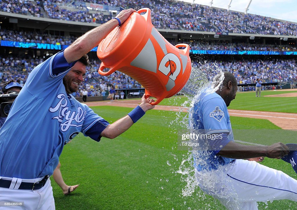 Lorenzo Cain #6 is doused with water by Drew Butera #9 of the Kansas City Royals as they celebrate a 5-4 win over the Chicago White Sox at Kauffman Stadium on May 29, 2016 in Kansas City, Missouri.