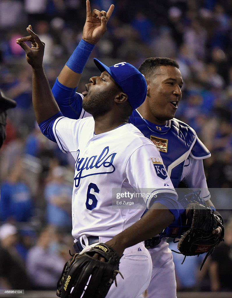 Lorenzo Cain #6 of the Kansas City Royals and Salvador Perez #13 celebrate a 7-5 win over the Chicago White Sox on April 8, 2015 at Kauffman Stadium in Kansas City, Missouri.