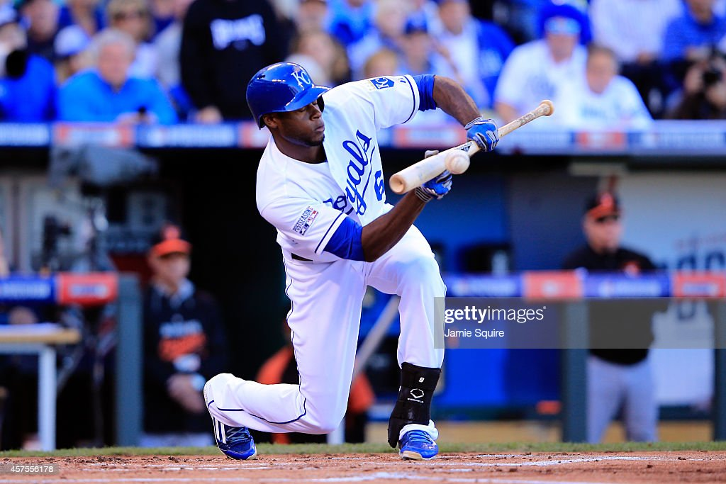 Lorenzo Cain of the Kansas City Royals bunts against the Baltimore Orioles during Game Four of the American League Championship Series at Kauffman...