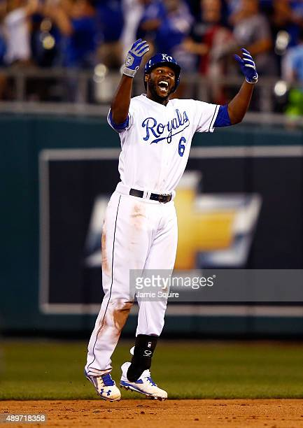 Lorenzo Cain of the Kansas City Royals celebrates after hitting the gamewinning RBI to score Paulo Orlando during the 10th inning of the game against...