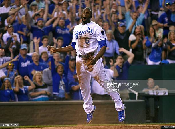 Lorenzo Cain of the Kansas City Royals celebrates after scoring the gamewinning run in the 10th inning against the Minnesota Twins at Kauffman...