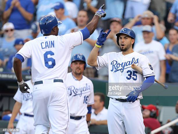 Lorenzo Cain of the Kansas City Royals celebrates his home run with Eric Hosmer of the Kansas City Royals in the first inning during a game against...