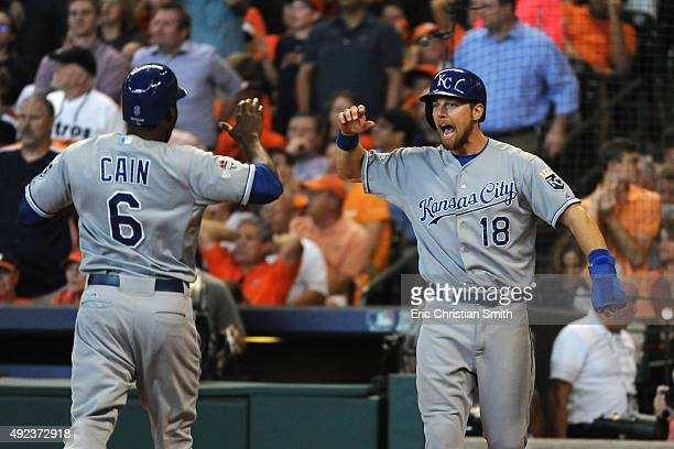 Lorenzo Cain of the Kansas City Royals celebrates scoring a run in the eighth inning with Ben Zobrist against the Houston Astros during game four of...