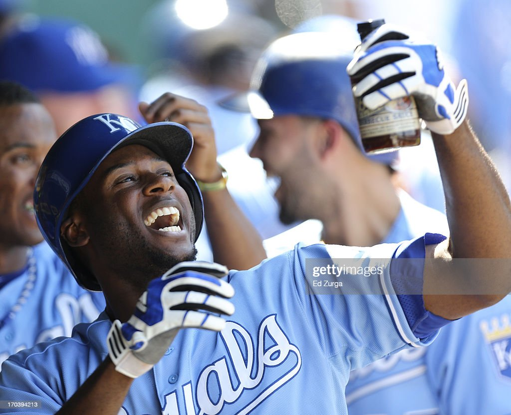 Lorenzo Cain #6 of the Kansas City Royals celebrates with a bottle of Rally Sauce after hitting a two-run home run in the ninth inning during a game against the Detroit Tigers at Kauffman Stadium on June 12, 2013 in Kansas City, Missouri. The Royals won 3-2 in 10 innings.