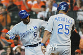 Lorenzo Cain of the Kansas City Royals celebrates with Kendrys Morales of the Kansas City Royals after hitting a solo home run in the fourth inning...
