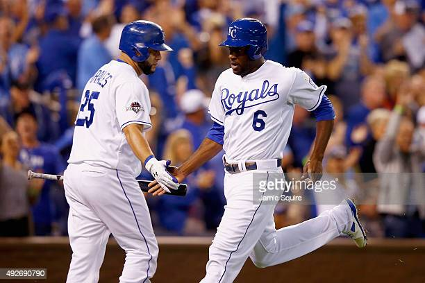 Lorenzo Cain of the Kansas City Royals celebrates with Kendrys Morales of the Kansas City Royals after scoring a run in the fourth inning after Eric...