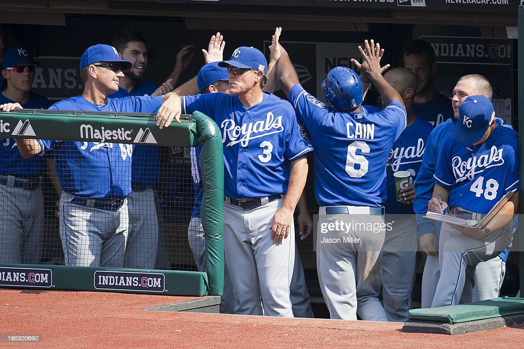 <a gi-track='captionPersonalityLinkClicked' href=/galleries/search?phrase=Lorenzo+Cain&family=editorial&specificpeople=5746615 ng-click='$event.stopPropagation()'>Lorenzo Cain</a> #6 of the Kansas City Royals celebrates with teammates after scoring on a single by Mike Moustakas #8 during the eighth inning against the Cleveland Indians at Progressive Field on September 11, 2013 in Cleveland, Ohio. The Royals defeated the Indians 6-2.