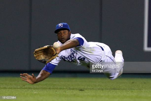 Lorenzo Cain of the Kansas City Royals dives and makes the catch on a ball off the bat of Austin Jackson of the Detroit Tigers during the ninth...