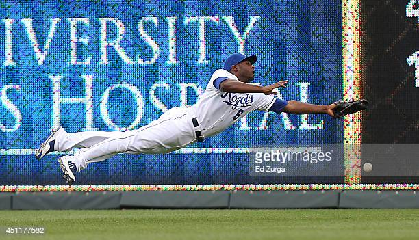Lorenzo Cain of the Kansas City Royals dives but can't catch a ball hit by Justin Turner of the Los Angeles Dodgers in the first inning at Kauffman...