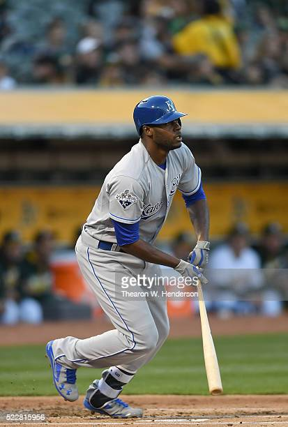 Lorenzo Cain of the Kansas City Royals hits an rbi single scoring Alcides Escobar against the Oakland Athletics in the top of the first inning at Oco...