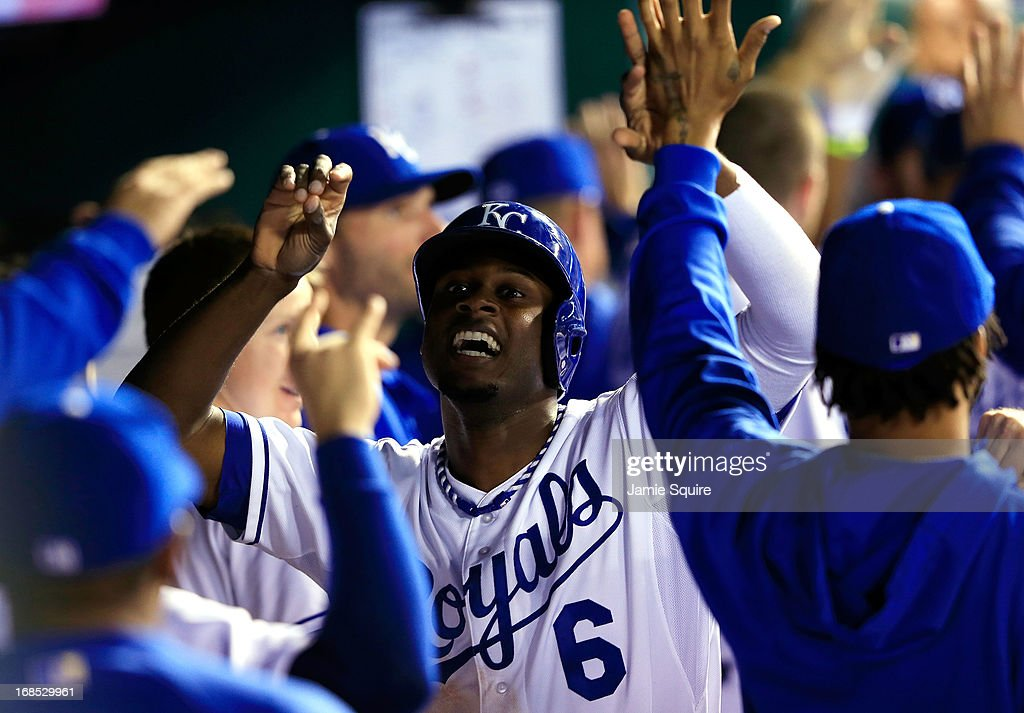 <a gi-track='captionPersonalityLinkClicked' href=/galleries/search?phrase=Lorenzo+Cain&family=editorial&specificpeople=5746615 ng-click='$event.stopPropagation()'>Lorenzo Cain</a> #6 of the Kansas City Royals is congratulated by teammates in the dugout after scoring during the 5th inning of the game at Kauffman Stadium on May 10, 2013 in Kansas City, Missouri.
