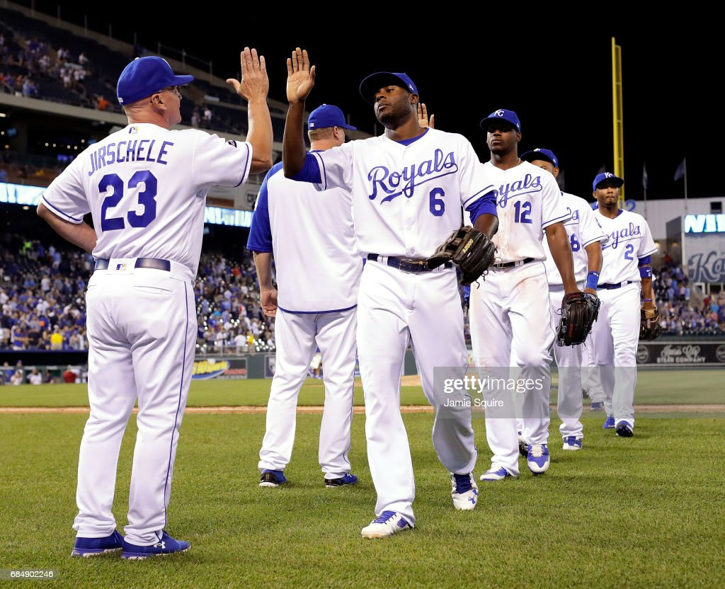 Lorenzo Cain #6 of the Kansas City Royals is congratulated by third base coach Mike Jirschele #23 after the Royals defeated the New York Yankees to win the game 5-1 at Kauffman Stadium on May 18, 2017 in Kansas City, Missouri.