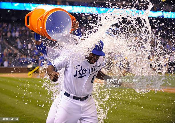 Lorenzo Cain of the Kansas City Royals is doused with water by teammate Salvador Perez as they celebrate a 75 win over the Chicago White Sox on April...