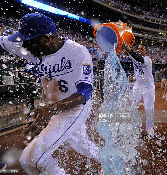 Lorenzo Cain of the Kansas City Royals is doused with water by Salvador Perez as they celebrate a 81 win over the Minnesota Twins at Kauffman Stadium...