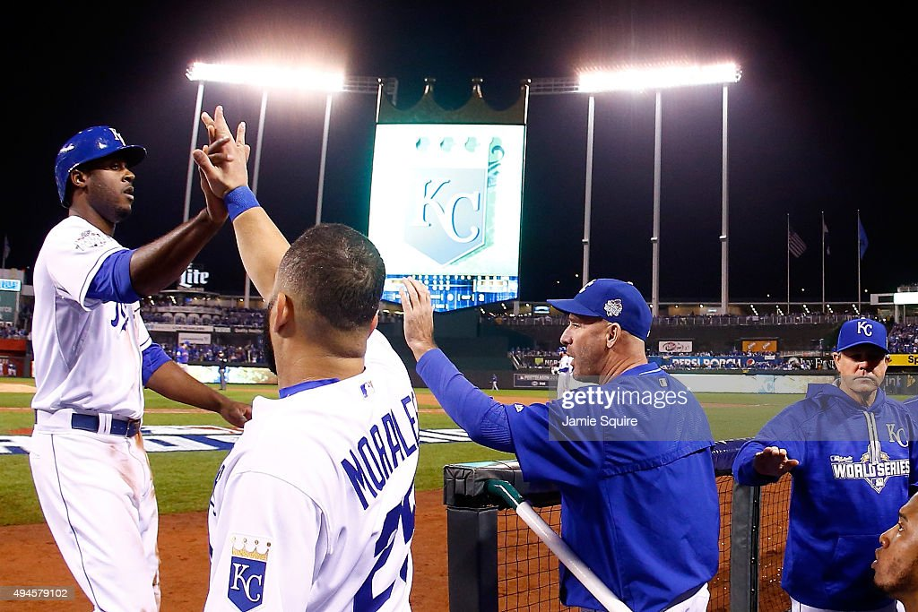 <a gi-track='captionPersonalityLinkClicked' href=/galleries/search?phrase=Lorenzo+Cain&family=editorial&specificpeople=5746615 ng-click='$event.stopPropagation()'>Lorenzo Cain</a> #6 of the Kansas City Royals is greeted by Kendrys Morales #25 of the Kansas City Royals at the dugout after scoring a run on an RBI single hit by Mike Moustakas #8 of the Kansas City Royals (not pictured) in the sixth inning against the New York Mets during Game One of the 2015 World Series at Kauffman Stadium on October 27, 2015 in Kansas City, Missouri.