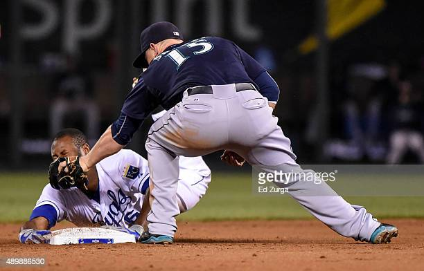 Lorenzo Cain of the Kansas City Royals is tagged out by Kyle Seager of the Seattle Mariners as he tries stretch a tworun single in the sixth inning...