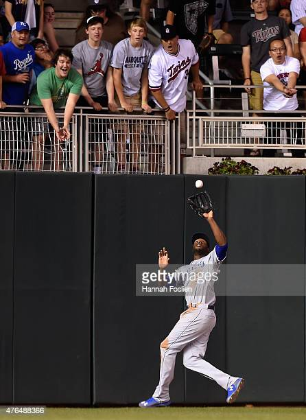 Lorenzo Cain of the Kansas City Royals makes a catch of the ball hit by Joe Mauer of the Minnesota Twins in center field during the seventh inning of...
