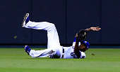 Lorenzo Cain of the Kansas City Royals makes a diving catch against the Los Angeles Angels in the fifth inning during Game Three of the American...