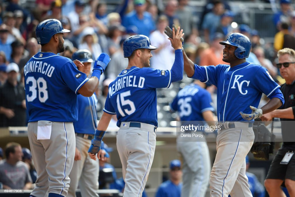 Lorenzo Cain #6 of the Kansas City Royals, right, is congratulated by Whit Merrifield #15 and Jorge Bonifacio #38 after hitting a grand slam during the eighth inning of a baseball game against the San Diego Padres at PETCO Park on June 10, 2017 in San Diego, California.