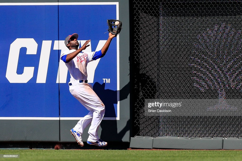 Lorenzo Cain #6 of the Kansas City Royals runs into the wall while making a catch against the Baltimore Orioles during the eighth inning at Kauffman Stadium on May 14, 2017 in Kansas City, Missouri. Players are wearing pink to celebrate Mother's Day weekend and support breast cancer awareness.