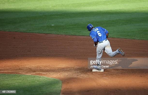 Lorenzo Cain of the Kansas City Royals runs the bases after his gamewinning solo home run in the 13th inning against the Chicago White Sox at US...