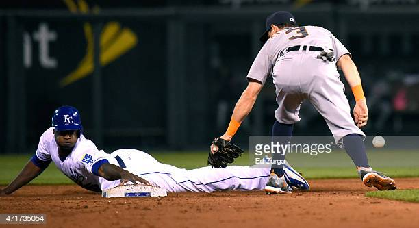 Lorenzo Cain of the Kansas City Royals slides into second for a stolen base past Ian Kinsler of the Detroit Tigers in the fifth inning game on April...