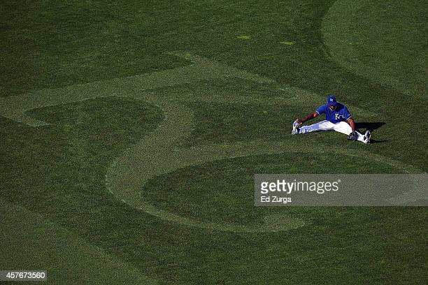Lorenzo Cain of the Kansas City Royals stretches in the outfield before Game Two of the 2014 World Series against the San Francisco Giants at...