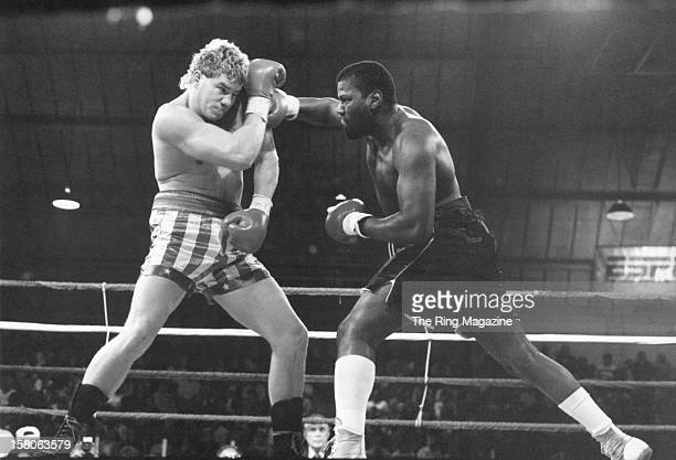 Lorenzo Canady throws a right hook against Tommy Morrison during the fight at the South Mountain Arena on November 141989 in West Orange New Jersey...