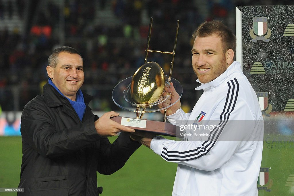 Lorenzo Cittadini (R) of Italy receives the award for the players of the match at the end of the international test match between Italy and Tonga at Mario Rigamonti Stadium on November 10, 2012 in Brescia, Italy.