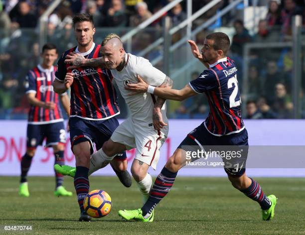 Lorenzo Crisetig and Noe Dussene Capezzi of Crotone competes for the ball with Radja Nainggolan of Roma during the Serie A match between FC Crotone...