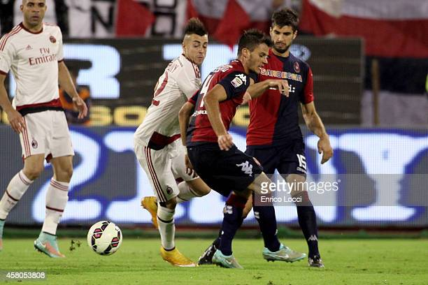 Lorenzo Crisetig of Cagliari battles with Stephan El Shaarawy of Milan during the Serie A match between Cagliari Calcio and AC Milan at Stadio...