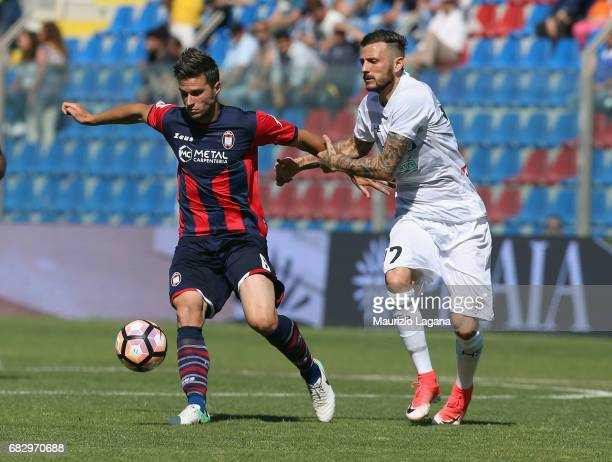 Lorenzo Crisetig of Crotone competes for the ball with Cyril Thereau of Udinese during the Serie A match between FC Crotone and Udinese Calcio at...