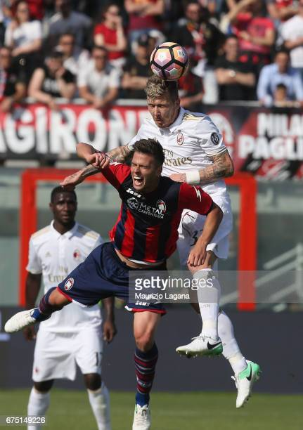 Lorenzo Crisetig of Crotone competes for the ball with Juraj Kucka of Milan during the Serie A match between FC Crotone and AC Milan at Stadio...