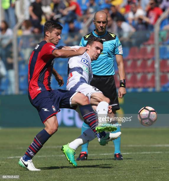 Lorenzo Crisetig of Crotone competes for the ball with Sven Kums of Udinese during the Serie A match between FC Crotone and Udinese Calcio at Stadio...