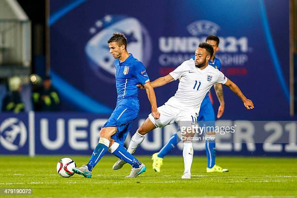 Lorenzo Crisetig of Italy competes for the ball with Nathan Redmond of England during the UEFA Under21 European Championship 2015 match between...