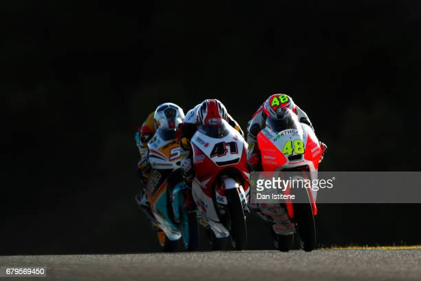 Lorenzo Dalla Porta of Italy and Aspar Mahindra Moto3 rides ahead of Nakarin Atiratphuvapat of Thailand and Honda Team Asia and Romano Fenati of...