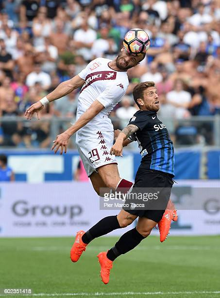 Lorenzo De Silvestri of FC Torino co mpetes for the ball with Alejandro Gomez of Atalanta BCduring the Serie A match between Atalanta BC and FC...