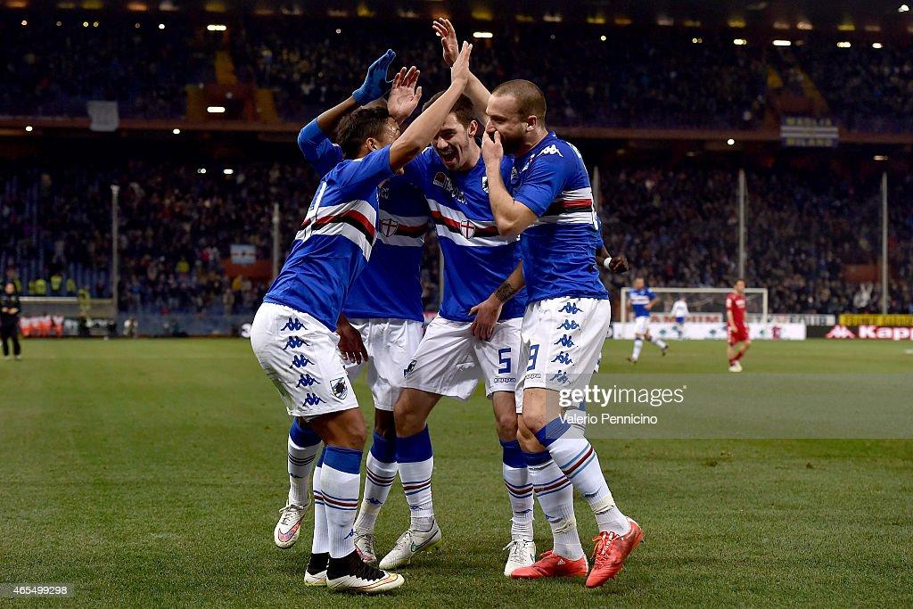 Lorenzo De Silvestri of UC Sampdoria celebrates after scoring the opening goal with team mates during the Serie A match between UC Sampdoria and...