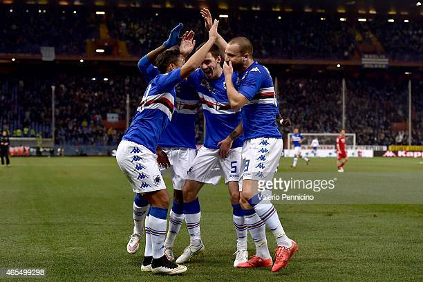Lorenzo De Silvestri of UC Sampdoria celebrates after scoring the opening goal with team mates during the Serie A match between UC Sampdoria and...
