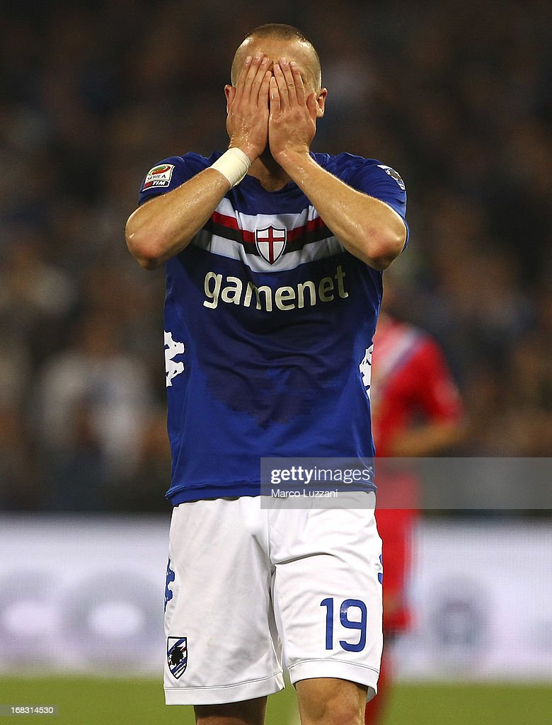 <a gi-track='captionPersonalityLinkClicked' href=/galleries/search?phrase=Lorenzo+De+Silvestri&family=editorial&specificpeople=4533237 ng-click='$event.stopPropagation()'>Lorenzo De Silvestri</a> of UC Sampdoria shows his dejection during the Serie A match between UC Sampdoria and Calcio Catania at Stadio Luigi Ferraris on May 8, 2013 in Genoa, Italy.