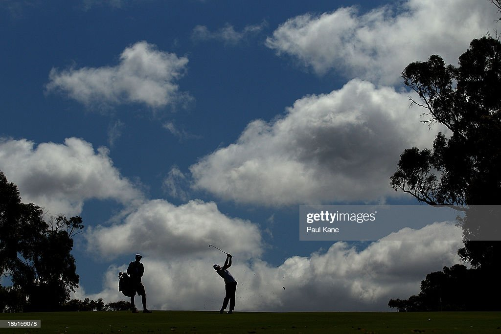 Lorenzo Gagli of Italy plays his approach shot on the 13th hole during day two of the Perth International at Lake Karrinyup Country Club on October 18, 2013 in Perth, Australia.