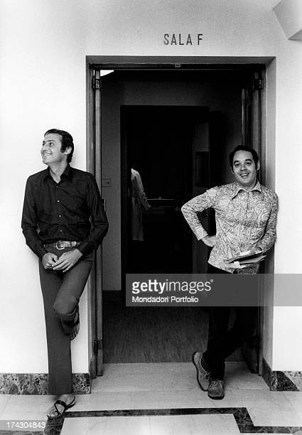 Lorenzo Giovanni Arbore known as Renzo Arbore together with Gianni Boncompagni at the studio doorway where they record the episodes of the program...