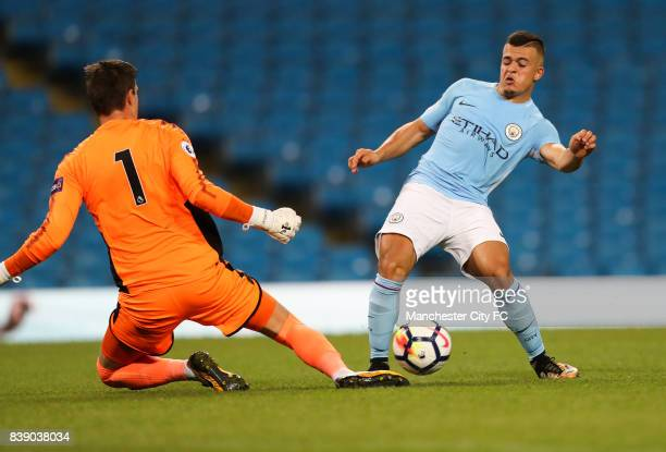 Lorenzo Gonzalez of Manchester City is beaten to the ball by Eldin Jakupovic of Leicester City during the match between Manchester City and Leicester...