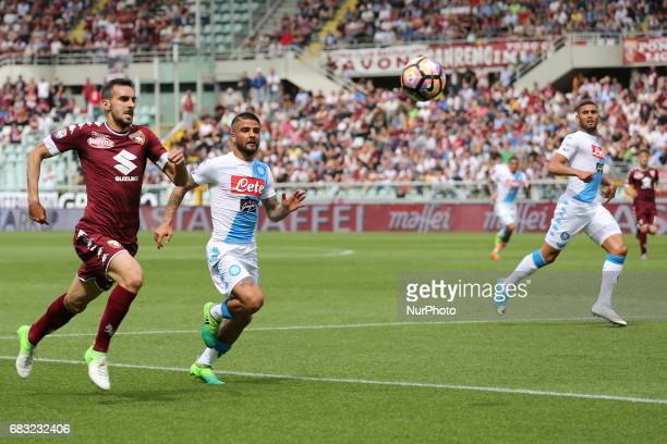 Lorenzo Insigne and Davide Zappacosta compete for the ball during the Serie A football match between Torino FC and SSC Napoli at Olympic stadium...